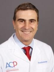 Dentist, Dr. Leonardo Frydman, DMD, CAGS, HBI